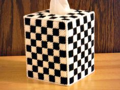 This is a white and black checker tissue box cover. Same design on all four sides. I used: worsted weight acrylic yarn and plastic Canvas. .