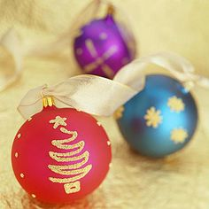 For ornaments that dazzle, decorate satin-finish balls with dimensional paint and shower them with the tiniest of beads.