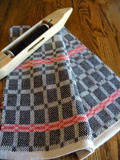 From one warp I was able to weave many different towels and a table runner. The soldier blue, sunny yellow and white drall blocks in t...
