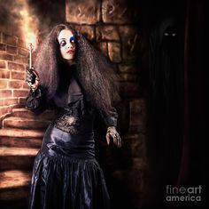 Medieval photo illustration of a jester woman holding torch lantern while walking inside a dark stone staircase deep inside the basement of a vintage haunted castle. Halloween concept by Ryan Jorgensen