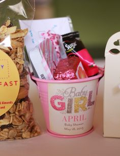 Baby Shower Favors with stickers from Tiny Prints, pink buckets, popband hair ties, Bliss Sugar flavored sugar packets, Fudge, Cao Chocolates.