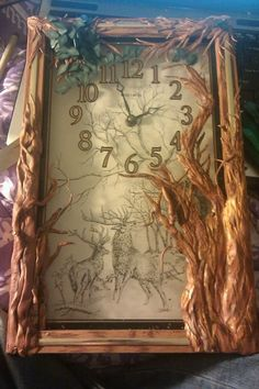 Old 70's style clock, found at thrift store for five bucks. In the beginning stages of being revamped with polymer clay trees, flowers, etc. See board for after pics..