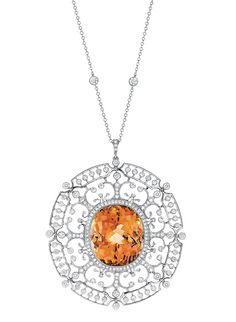 Tiffany & Co. Medallion pendant with orange tourmaline and diamonds set in platinum.