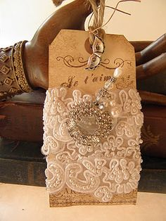 gorgeous tags with lovely lace - just stunning for your wedding! -  there appears to be a pearl topped stick pin as well   -  ldcd