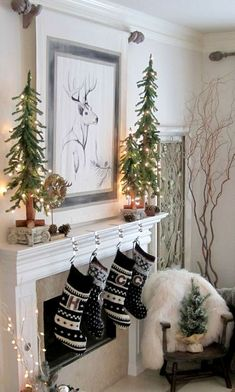 Christmas mantel with stockings, trees and pinecones