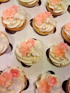 pink and white cupcakes with sugarpaste flowers and butterflies