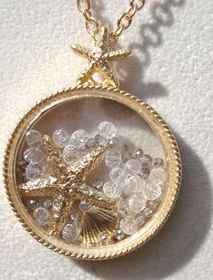 Love this shaker locket with crystals and shells and starfish! Gorgeous for summer!