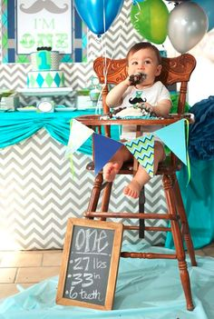 I love the idea of having the cake table close to her high chair. Makes it able for everyone to adore the cake and her at same time.