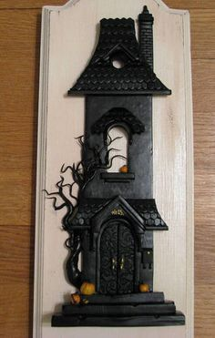 Halloween House - I finally found out who the artist is! ;) http://cackleandhoot.com/happy-halloween/