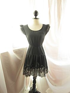 Beautiful dress by River of Romansk on etsy. I love the detail around the hem.