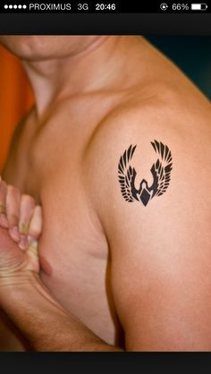 Small Phoenix tattoo tribal for men