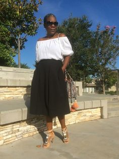 So What to Twenty! A beaded tassel bucket bag, along with beaded sandals are the inspiration behind this look. A combination of an off-the-shoulder tee by Ann Taylor LOFT and H&M black midi skirt are the core pieces in this Navajo inspired look.