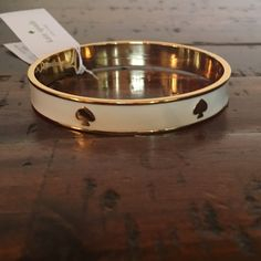 Kate Spade Bangle New Kate Spade Bangle/Bracelet   Color: Cream/Gold New with tags  PRICE IS FIRM  No free shipping  No trades kate spade Jewelry Bracelets