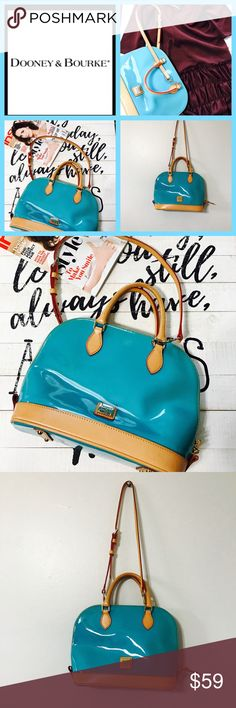 """AUTHENTIC DOONEY and BOURKE ZIP ZIP satchel Welcome this zip zip satchel collection to your closet. Featuring a modern dome shape, this Blue PATENT makes a statement everywhere it goes. Accented with gilded hardware and crisp contrast trim, the optional shoulder strap provides you with styling versatility.H 9.5"""" x W 5.25"""" x L 12"""" Two inside pockets. One inside zip pocket. Cell phone pocket. Inside key hook. Handle drop length 4"""". Strap drop length 15.5"""". Lined. Zipper closure. Excellent…"""