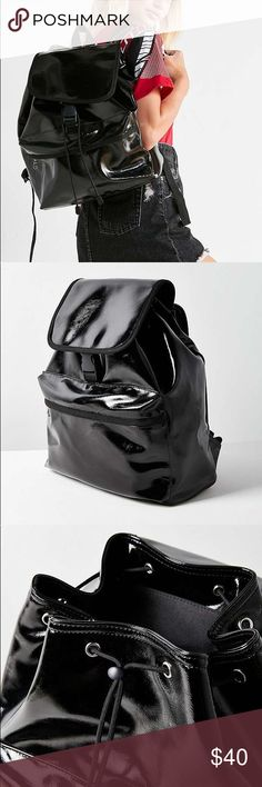 NEW Urban Outfitters patent backpack This is an awesome NEW patent faux leather backpack from Urban Outfitters. Tags attached. Featuring a drawstring flap-front buckled closure with a spacious interior pocket and outer zippered accessories pocket. Made out of patent faux leather with a high-shine finish. Adjustable shoulder straps and woven top carrying handle. Urban Outfitters Bags Backpacks
