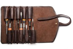 Vegetable Tanned Leather Tool Roll - Kaufmann Mercantile This portable tool roll is made from vegetable tanned leather, which has been dyed, finished and waxed by hand in New York. The English brass buckle allows you to adjust the length of the carrying strap, which is secured onto the carrier with hand-hammered English brass rivets.  There are five slots on each side of the carrier, with the pockets staggered so that tool heads fall in line and everything rolls up neatly.