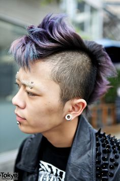 tokyo. piercings and lilac mohawk.