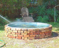 Galvanized Water Trough | Brickwork surrounding galvanized water trough goldfish pond completed.