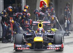Red Bull Formula One driver Webber leaves after a pit stop during the Chinese F1 Grand Prix at Shanghai circuit