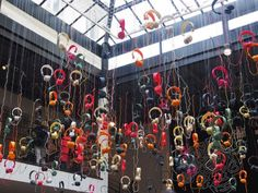 The fabulous Marais concept store Merci featured a colourful Urbanears Zinken headphones installation in the large central void