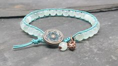 Turquoise leather and faceted gemstone bracelet with copper button £10.00