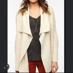 Staring at the Stars Nubby Boucle Cardigan Never worn. New condition. Ivory color. Soft knit Boucle cardigan. Ribbed knit open placket, hem and cuffs. Drapey, relaxed silhouette. Sold out but was exclusively for Urban Outfitters Urban Outfitters Sweaters Cardigans