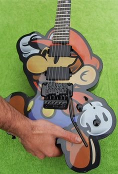 Custom Super Mario Bros ElectricGuitar. [BC Note: Yikes, not sure that's the correct way to hold it though]