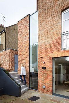 Brick walls, black frames and tall windows. (Stunning west London house extension featuring a window that stretches up to the roof. Modern Brick House, Brick House Designs, Brick Architecture, Contemporary Architecture, Interior Architecture, Minimalist Architecture, Architecture Portfolio, Modern Interior, Facade Design