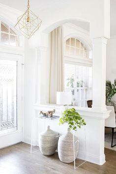 Entryway with lucite console table