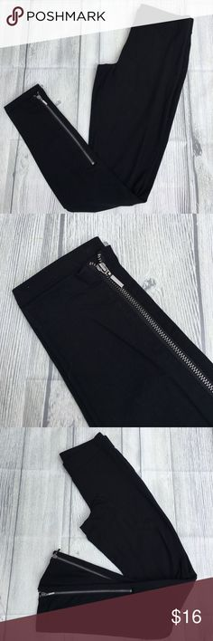 """GAP Black Leggings with Zippers Black leggings have an elastic waist and gold zippers up the outside of each leg. Measure 12""""inches across the top, 34""""inches long with a 27""""inch inseam. 93% cotton 7% Spandex. GAP Pants Leggings"""