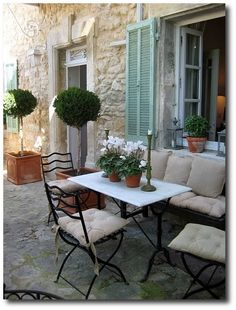 Love the stone to match front of my home and the use of the shutters! Veranda magazine, French style patio
