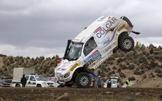 <strong>(1 of 3)</strong> Argentine Juan Manuel Silva and Pablo Sisterna (not pictured) crash and roll their Mercedes car during the 7th stage of the Dakar Rally from Iquique to Uyuni on January 10.