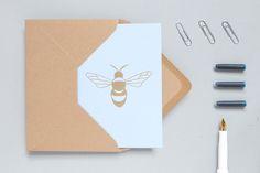 ola bee print card in brass on blue.jpg
