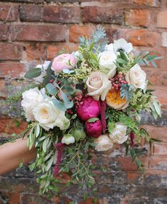 fabulously wild bridal bouquet of roses ranunculus peony and foliages  by @pennyjohnsonflowers #bridalbouquet #bridesbouquet #blushrose #cerisepeony #peachrose #eucalyptus