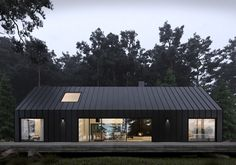 What do you think about this design? The Forest House is designed and visualized by Anastasiia Sholopova and is located in Ukraine House Cladding, Zinc Cladding, Modern Barn House, Black House Exterior, Shed Homes, House In The Woods, Exterior Design, Modern Exterior, Building A House