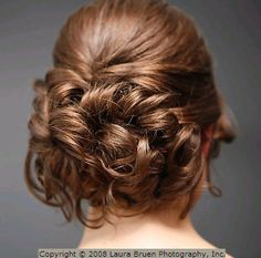 I like the contrast of the smooth top and the riot of curls underneath.