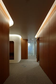 T.S.R.Building by Jun'ichi Ito Architect & Associates.  A psychiatric clinic. #WoodPaneling and #Lighting in ceiling coves.