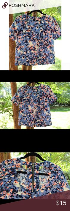 Anthropologie Watercolor Tee 100% Polyester, thick, high quality material, blue, black, white, & neon peach colored print, cutouts and exposed zipper in back, worn 1-2 times, in great condition Anthropologie Tops Tees - Short Sleeve
