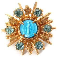 Hey, I found this really awesome Etsy listing at https://www.etsy.com/listing/218981116/vintage-blue-rhinestone-gold-tone