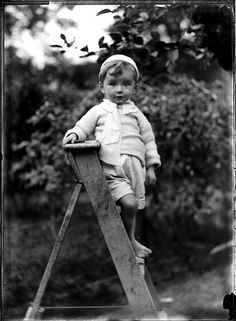 The Commons - Portrait of small barefoot boy on a wooden ladder by Powerhouse Museum Collection.