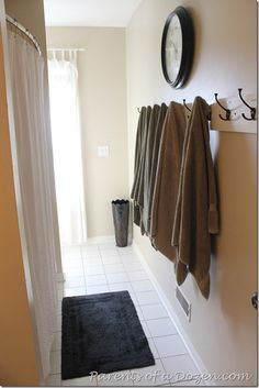 Hooks for towels instead of the traditional rod. #bathroomideas