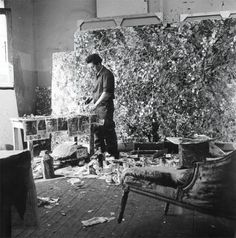 Jean-Paul Riopelle in his atelier rue Duratin, Paris, 1952 -by John Craven