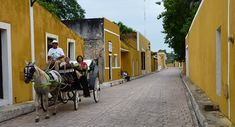 Izamal, Mexico.  i visited here almost 20 years ago, and happy to see that they still use horse-drawn buggies for taxis.  fantastic mayan history!