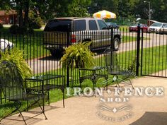 5ft tall wrought iron fence and gates used to section off a portion of driveway as a patio
