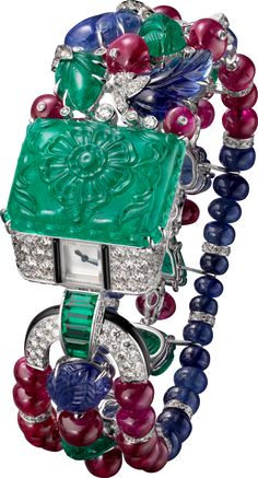 CARTIER Tutti Frutti Agrafe visible hour Watch - white gold, one 41.20-carat engraved emerald, engraved emeralds and sapphires, sapphire and ruby beads, brilliant-cut diamonds, baguette-cut emeralds, onyx.
