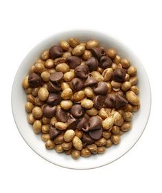 Soy nuts (¼ cup) plus 1 tablespoon chocolate chips | Between-meal bites don't have to be boring (or bad for you). Here are 42 tasty options—for the car, the couch, and beyond.