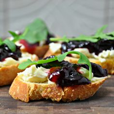 Crostini with cherry preserves, brie and arugula looks so sophisticated and yummy!