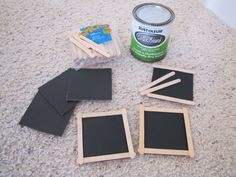 Mini chalkboards using cardboard, chalkboard paint, popsicle sticks, and Elmer's school glue. Good for prices.