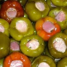 Cherry Peppers Stuffed with Prosciutto and Provolone. Just Cheesy Enough, Just Meaty Enough and Just Hot Enough!  This little appetizer takes no time to make and depending on the size of the Cherry Peppers, you may even be able to cut them in half or into quarter portions making your hors d oeuvre dollar go further! www.creativeelegancecatering.com www.creativeelegancecatering.blogspot.com