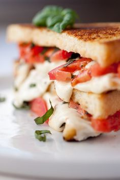 The basil, mozzarella, and tomato salad begs to be put between two pieces of bread, like in this caprese grilled cheese.